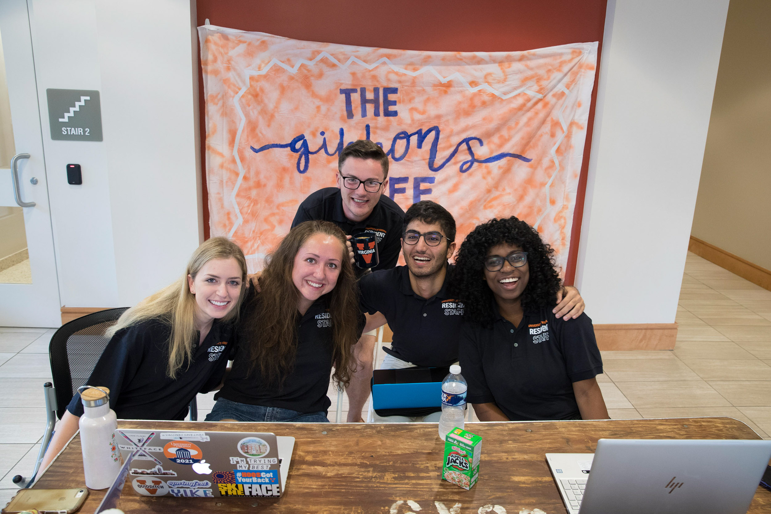 """Senior Resident Elizabeth Gillespie, far left, and her team fielded questions about parking and how to get in dorm rooms. """"It's going pretty well, and we are getting people where they need to be,"""" she said."""