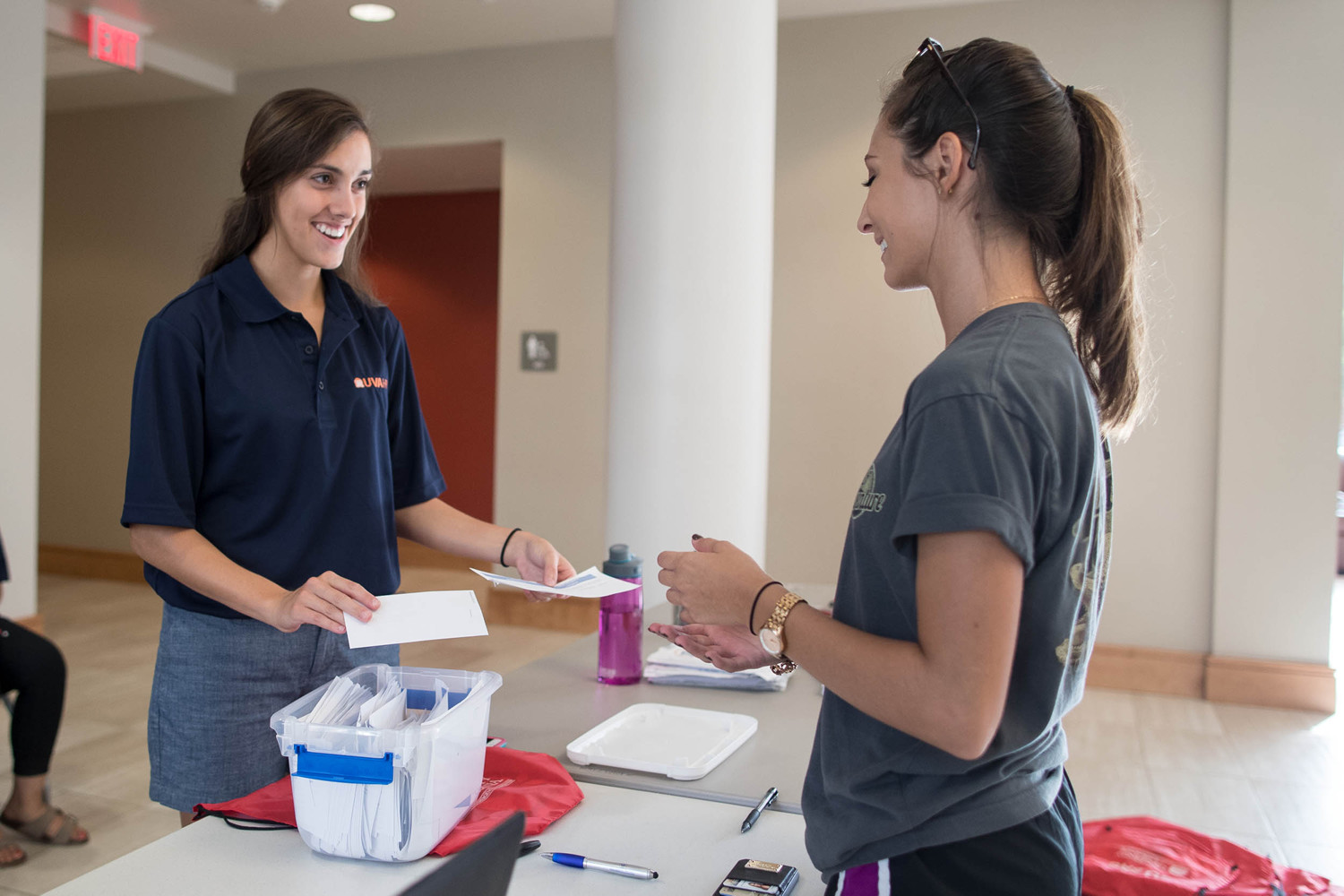 Resident assistant Allison Centineo welcomes a first-year student to Gibbons House.