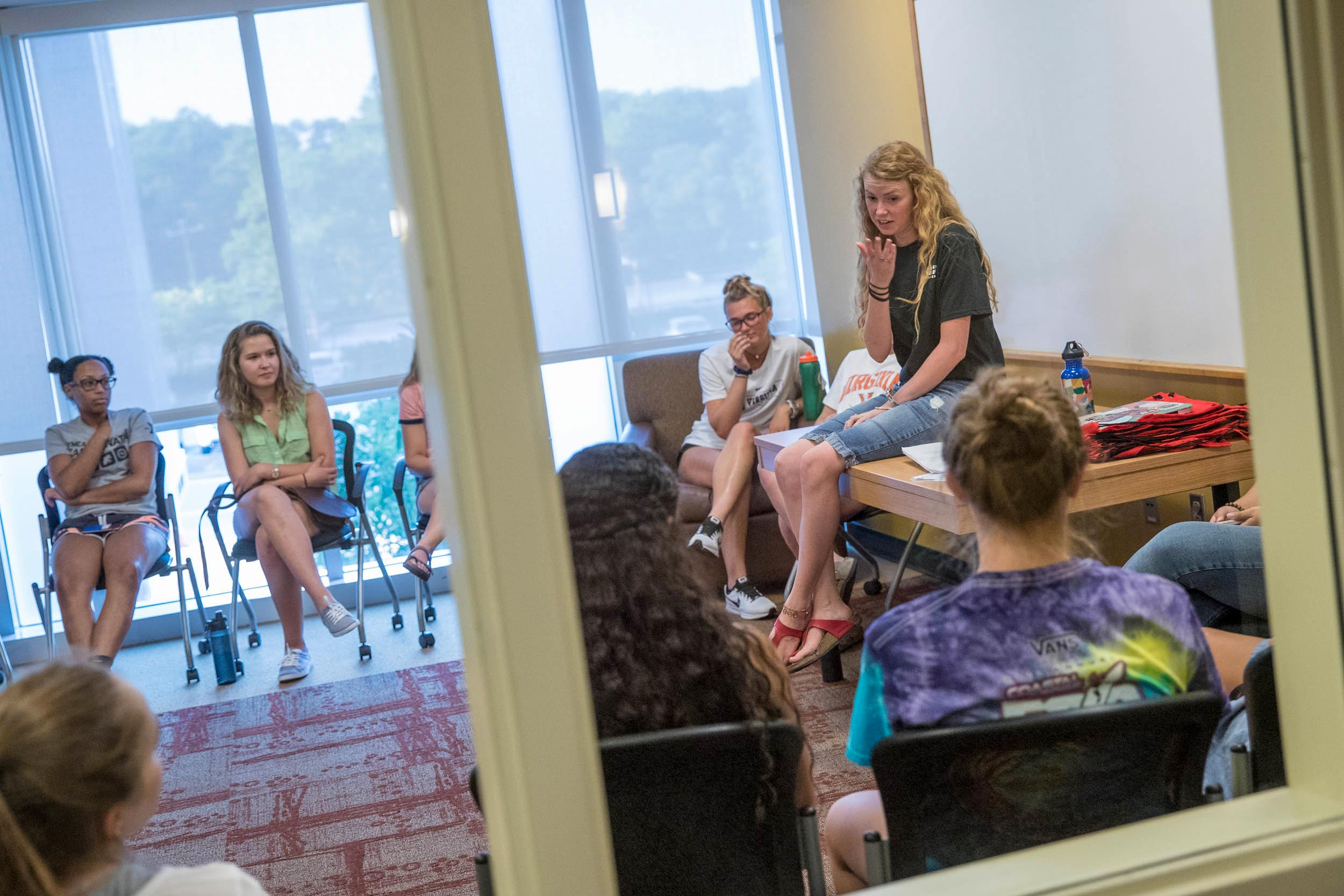 Former RA Rebecca Lewis addresses her hall in 2017. After move-in, every hall attends a mandatory welcome meeting where their RA answers questions and shares common rules.
