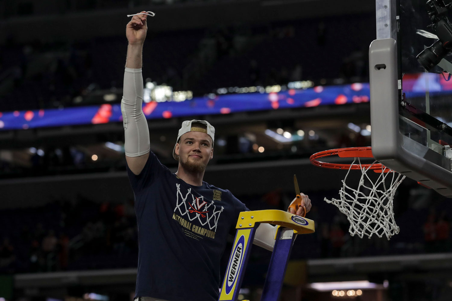 Jack Salt cutting part of the net after winning the 2019 NCAA basketball championship.