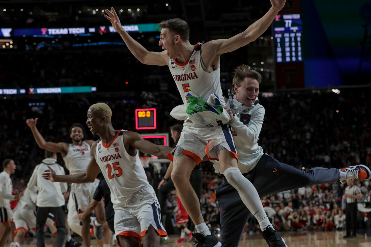 The final horn set off a massive celebration in U.S. Bank Stadium – for players, including Braxton Key, Mamadi Diakite, Kyle Guy and Grant Kersey, shown here, and for the fans who had cheered them on. (Photo by Sanjay Suchak, University Communications)