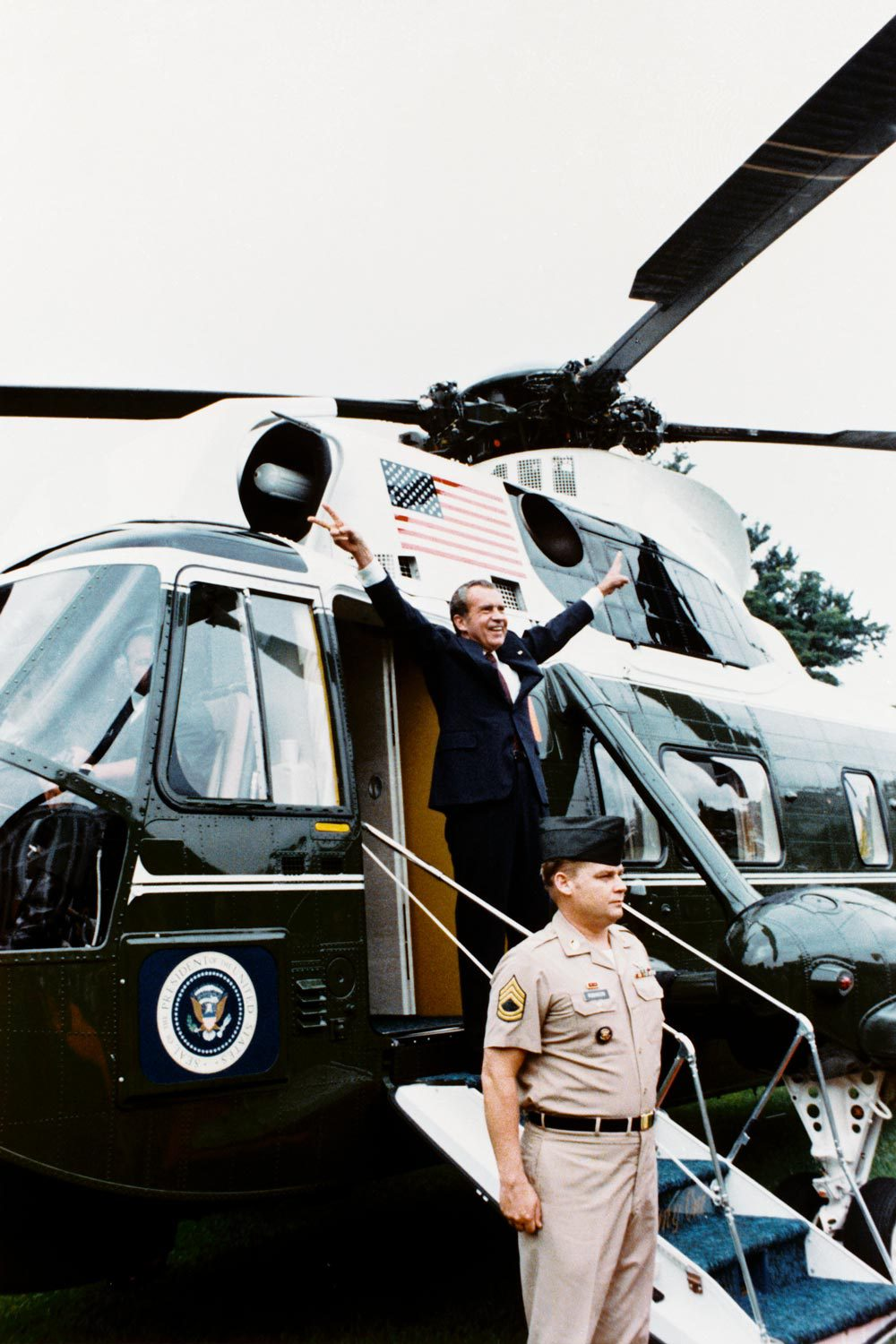 Richard Nixon, pictured waving farewell to staff, resigned after impeachment proceedings revealed his involvement in the Watergate break-in.