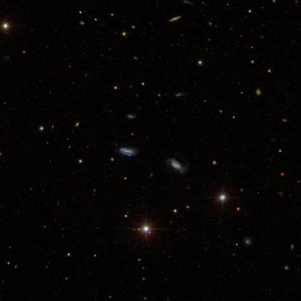 An image from the Sloan Digital Sky Survey shows a group of dwarf galaxies that are gravitationally bound together. (Sloan Digital Sky Survey)