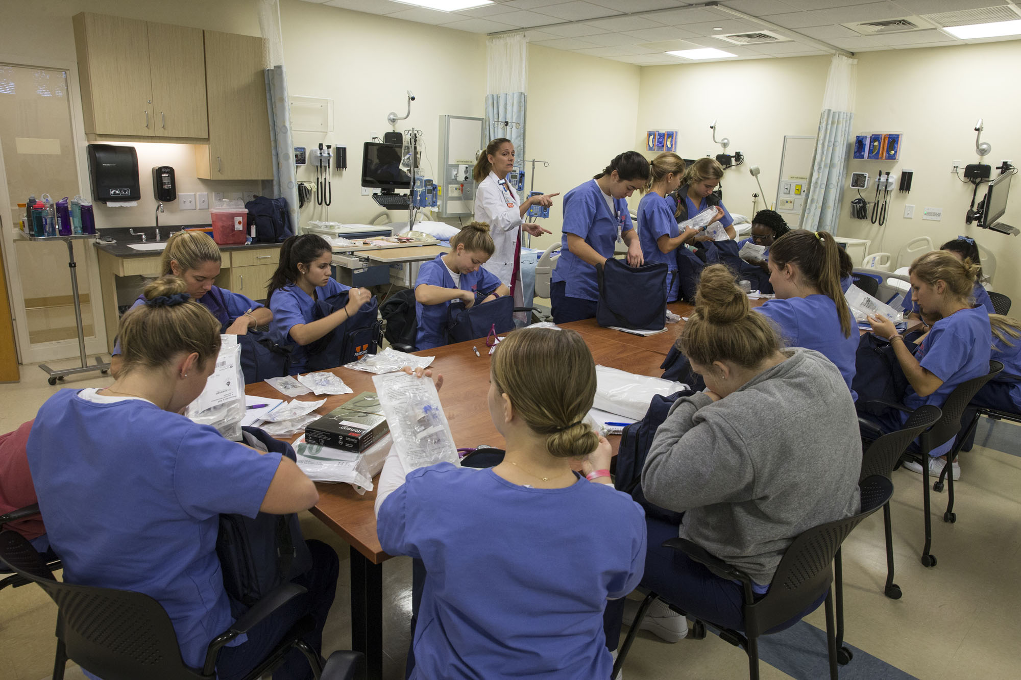 Second year nursing students in Professor Kathy Haugh's and Brook Lemieux's Health Assessment class practice examining one another's ears, eyes, noses and throats in the Mary Morton Parsons Clinical Simulation Learning Center.