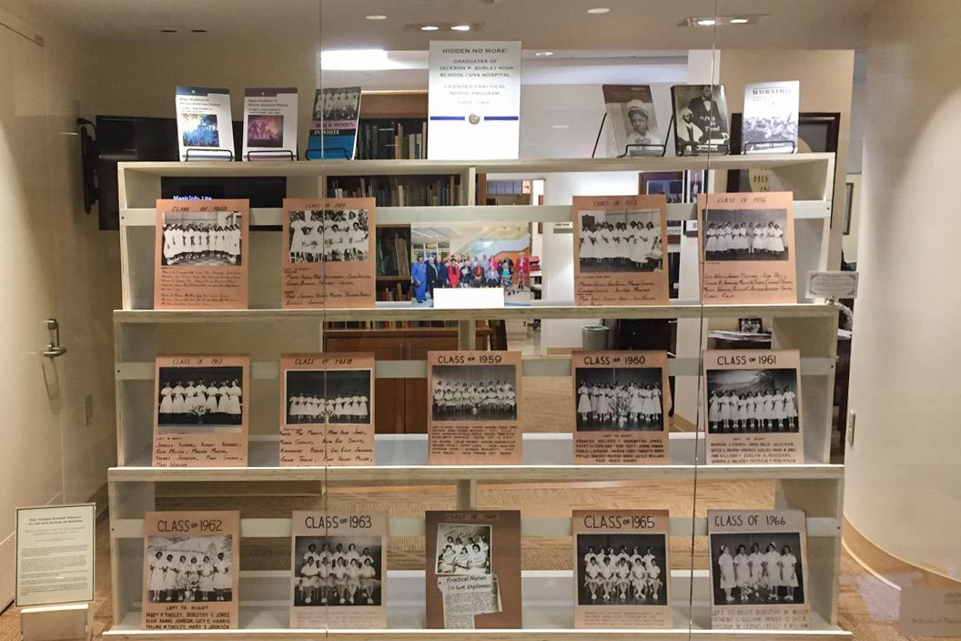 A display case in the School of Nursing's McLeod Hall lobby shows most of the LPN classes, and several related newspaper articles and books.