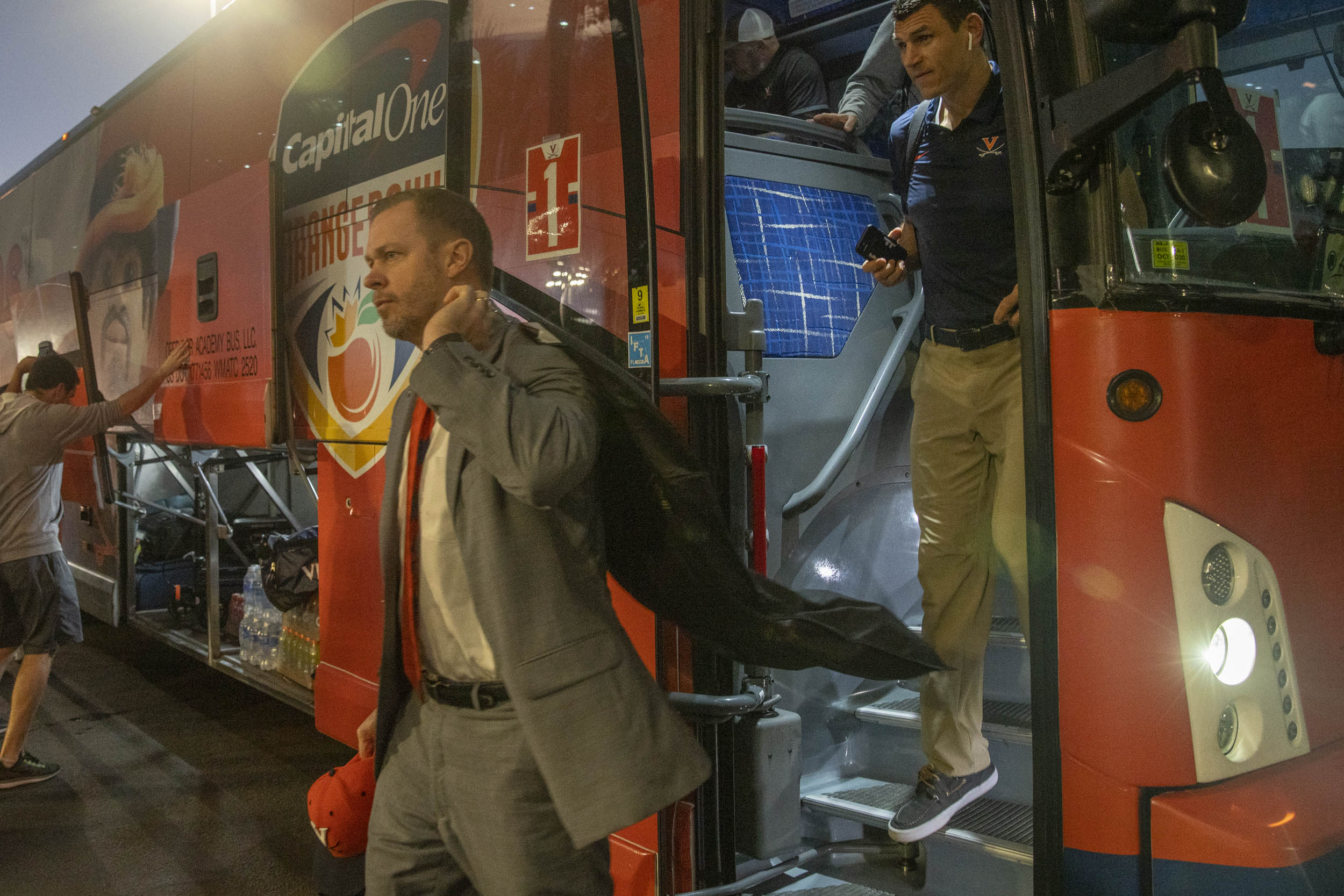 Mendenhall leads his team off the bus before the game.