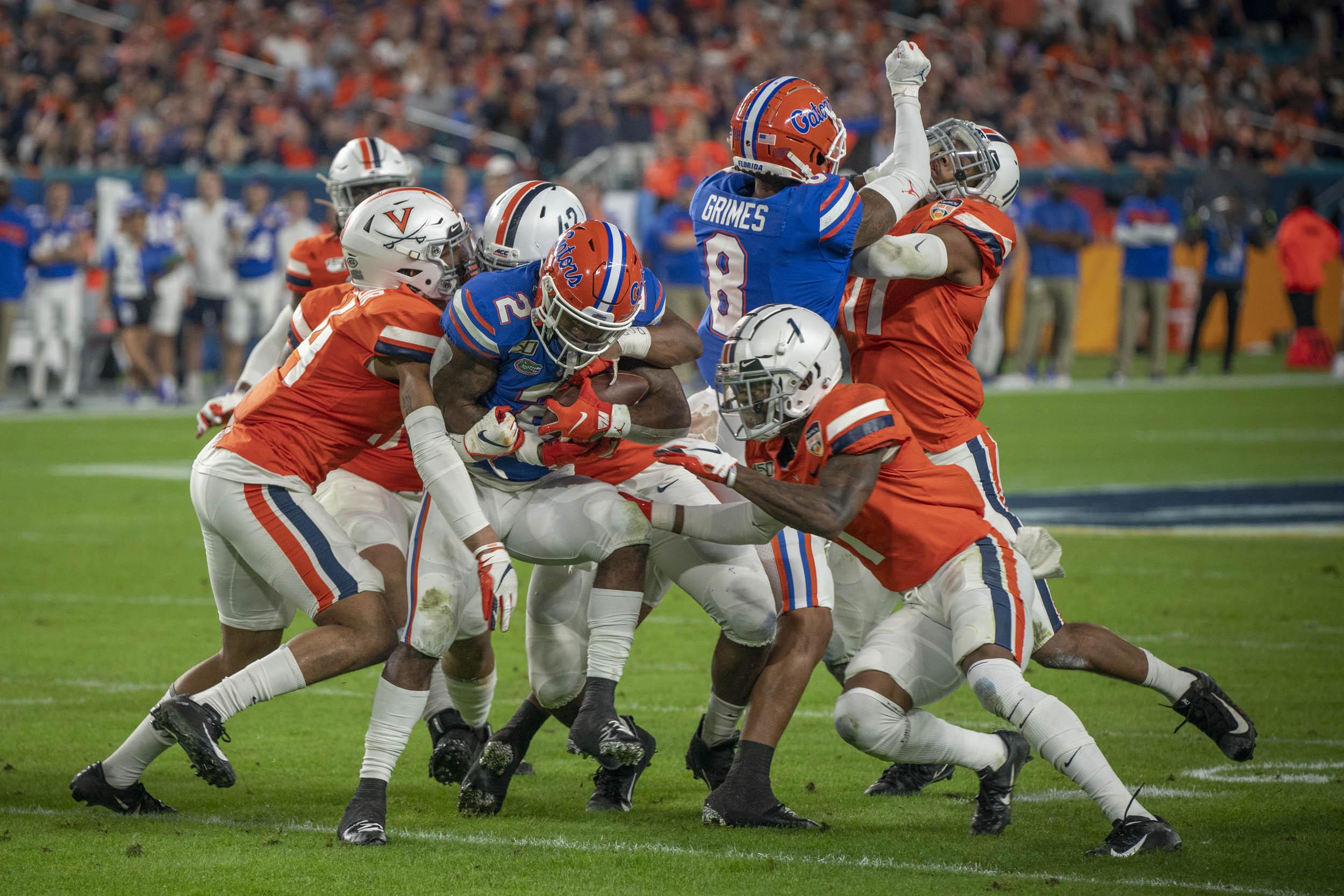 The UVA defense, here tackling star Florida running back Lamical Perine, played tough all night.