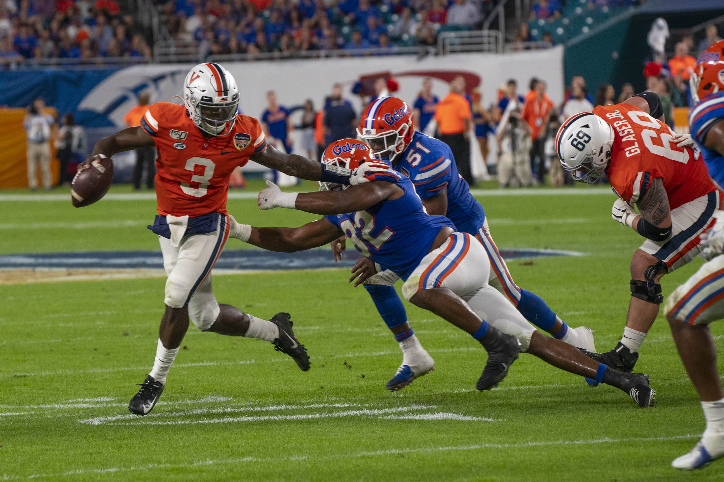 Perkins – about to let a touchdown pass fly – scrambles away from Florida defenders to get some room.