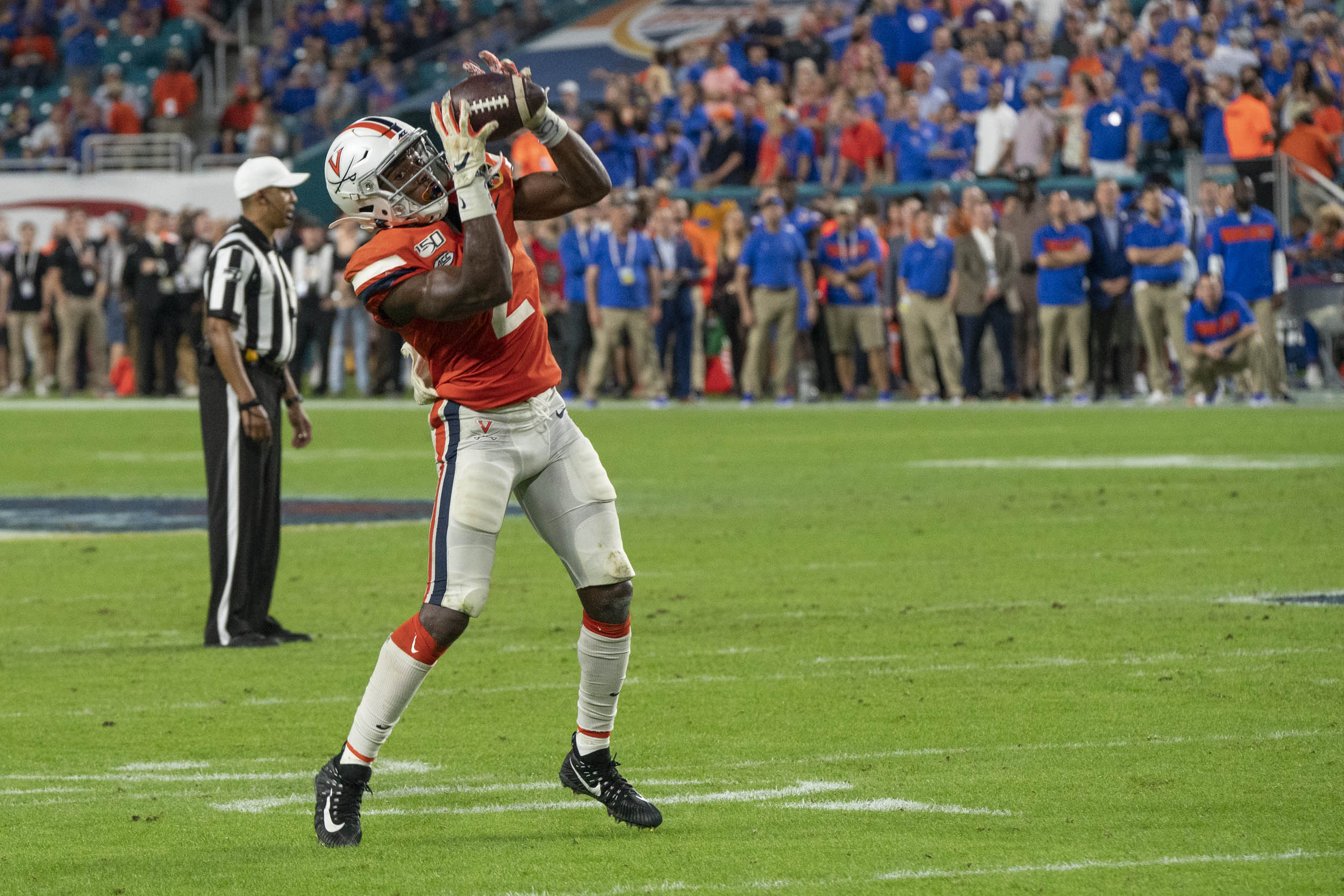 Wide receiver Joe Reed – responsible for one of UVA's four touchdown catches – makes a grab to keep a drive alive.