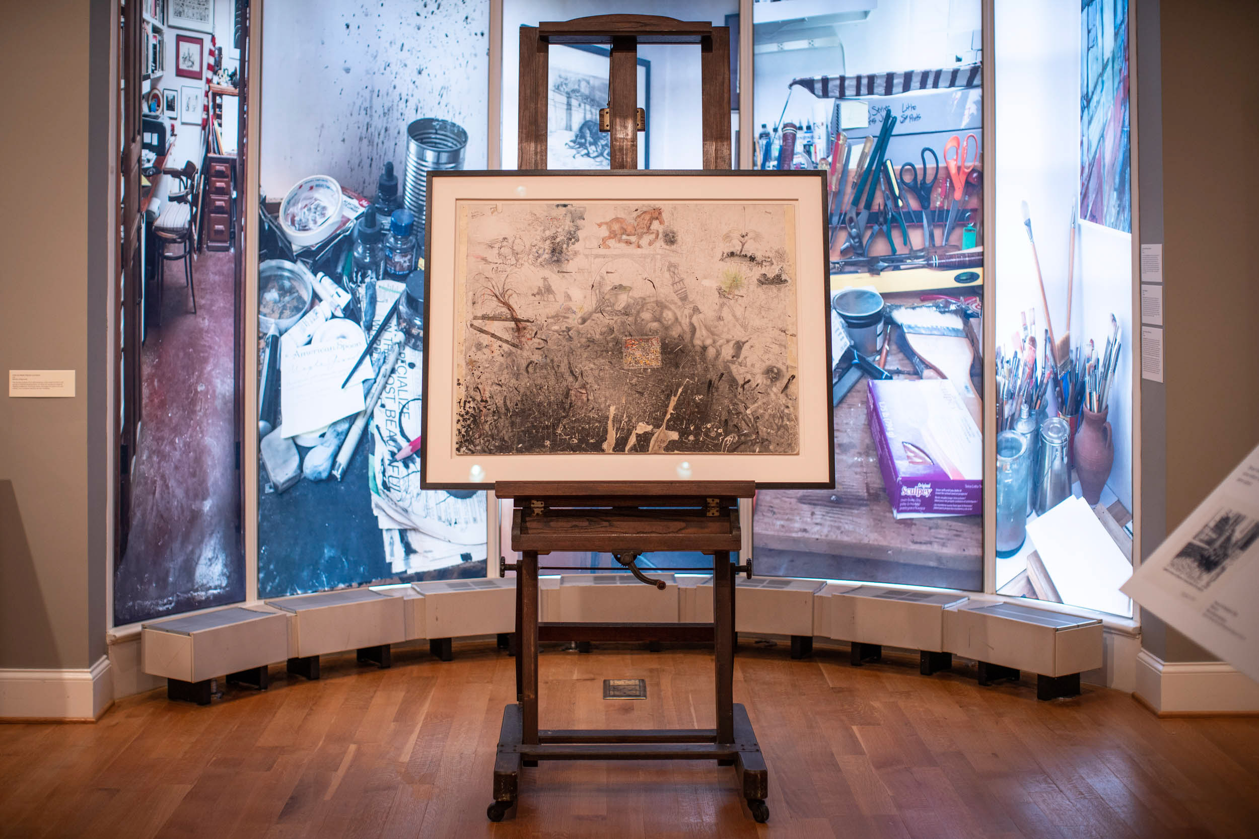 In front of the panels that show Oliphant's studio stands the only piece on loan from him: one of his drawing boards, which shows his imagination at play.