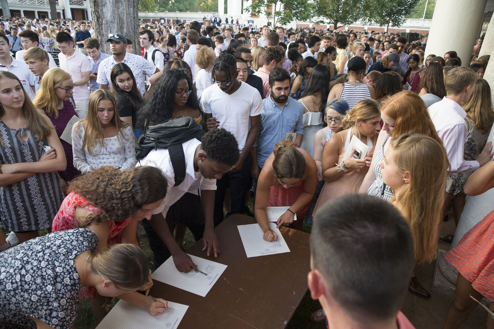 At the end of the ceremony, each new student officially signed the honor pledge.