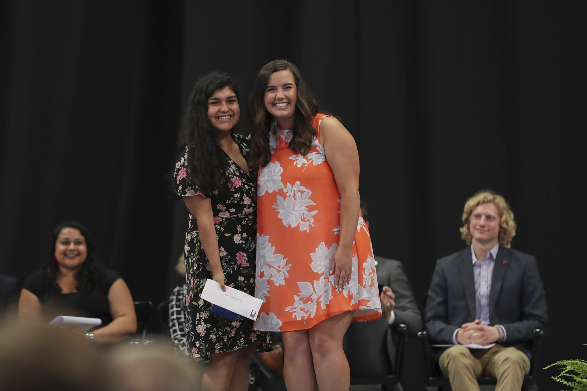 The Class of 2018, represented by trustee Holly Stevens, right, presented its Class Award for Community Service to education graduate Paola Sanchez Valdez.