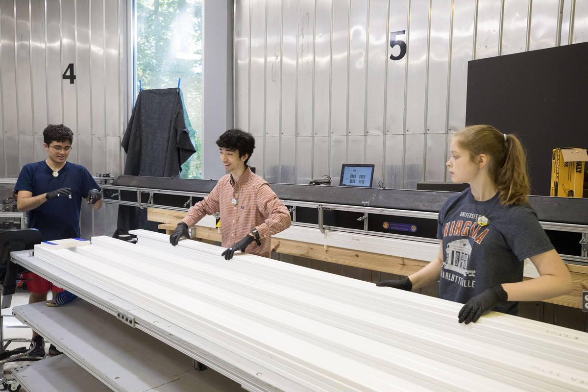 Physics students Michael Stepniczka, William Musk and Hannah Woodward select detectors to build a module.