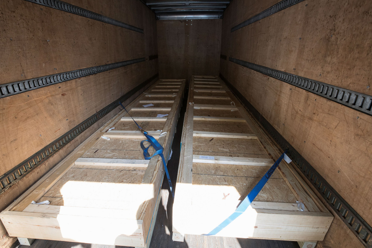 Two modules, loaded in a truck and strapped down, ready for shipment to Fermilab.