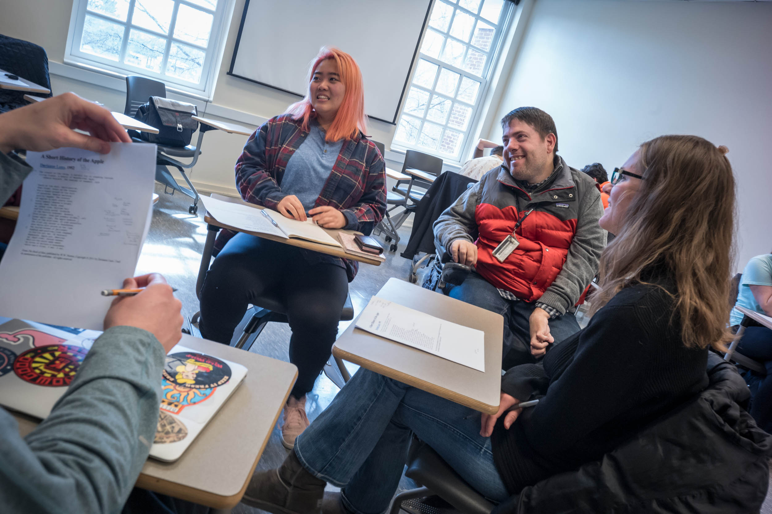 Guest teaches intermediate, advanced and graduate poetry writing workshops, and here talks with Allison Lee, center, and Kasey Roper, right, in a recent intermediate class.