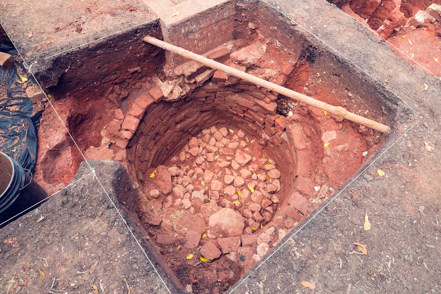 When decommissioned, the well was filled with stones and bricks.