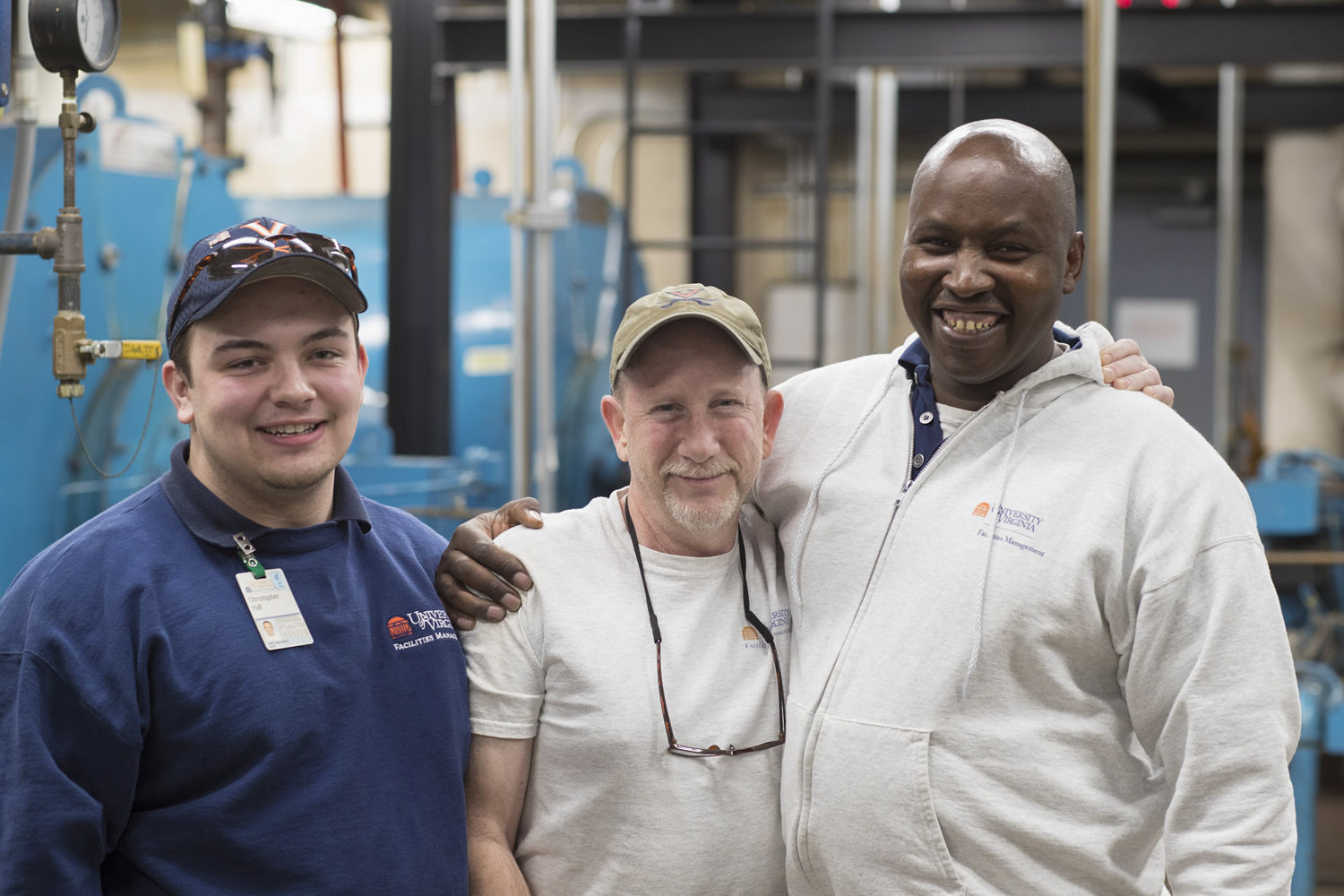 Chege, right, with fellow apprentice Christopher Hall, left, and HVAC mechanic Bill Kardos. Co-workers describe Chege as endlessly curious and eager to learn.