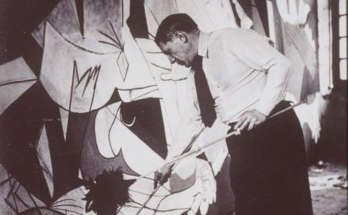 "Picasso painting ""Guernica"" in Paris in May of 1937."