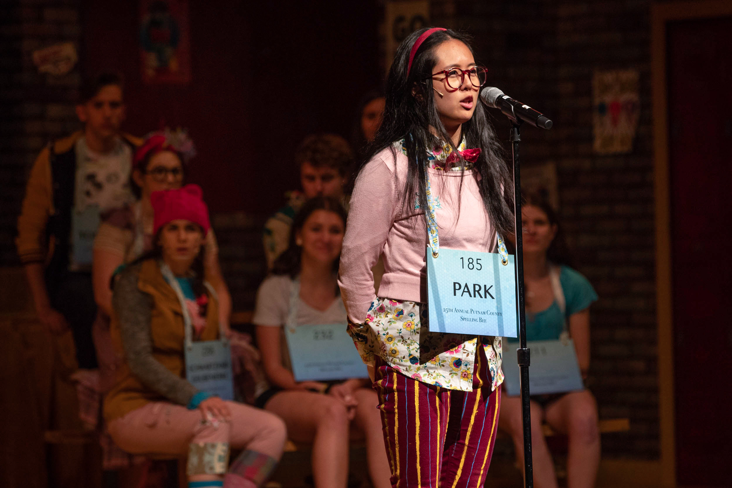 "Marcha Kiatrungrit rehearses for her role as Marcy Park in the drama department's production of ""The 25th Annual Putnam County Spelling Bee."""