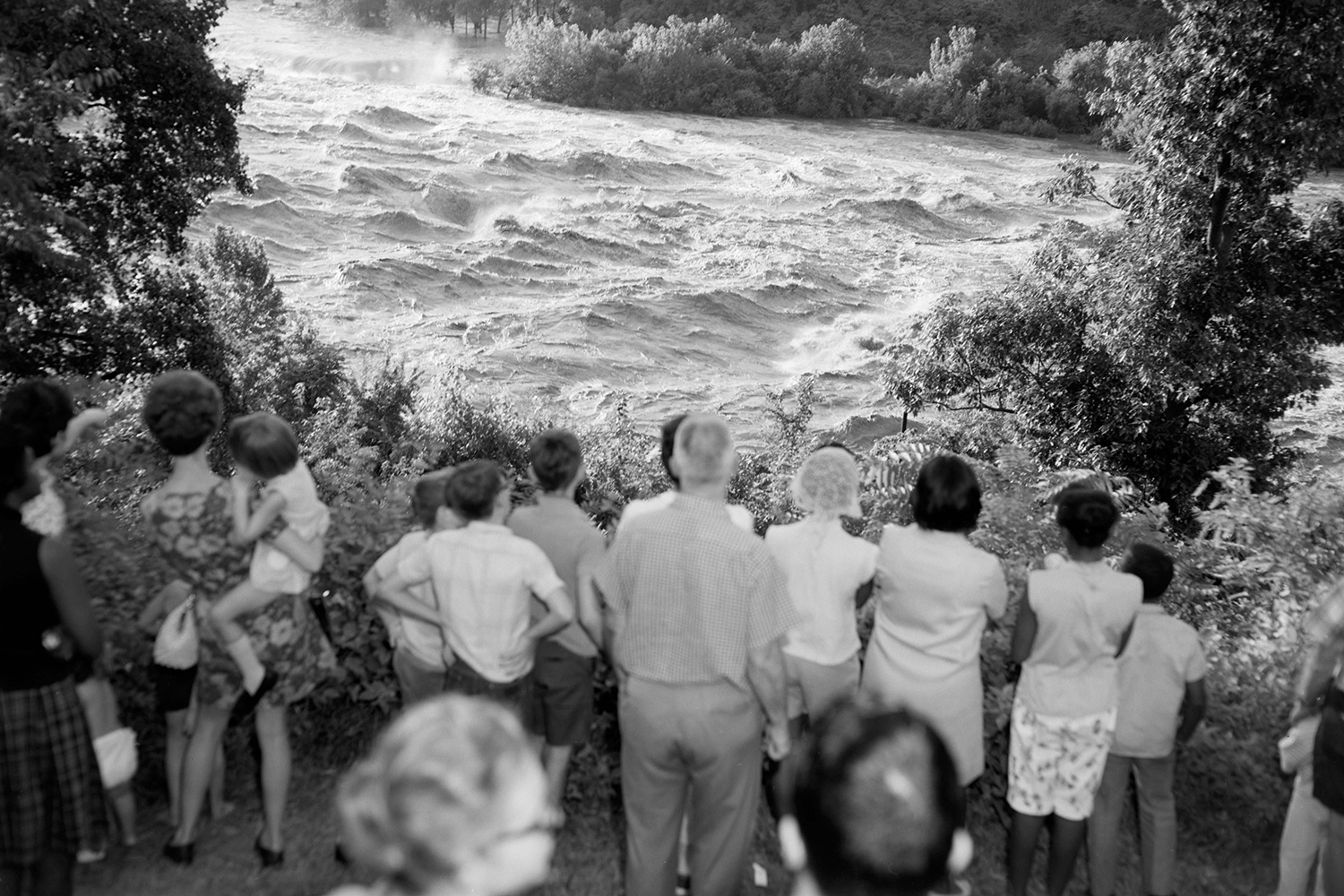 Onlookers gather to watch the flood waters of the James River near the south end of the Lee Bridge in Richmond. The James River peaked at 28.6 ft in Richmond from Hurricane Camille. (Photo courtesy The Library of Virginia/Flickr Commons)