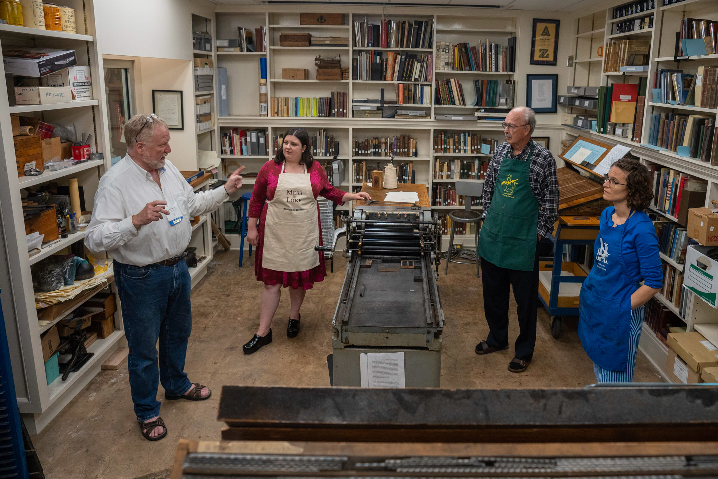 Instructor John Kristensen, far left, talks about printing with students Amanda Rogus, Bill Bryson and Lydia Fash.