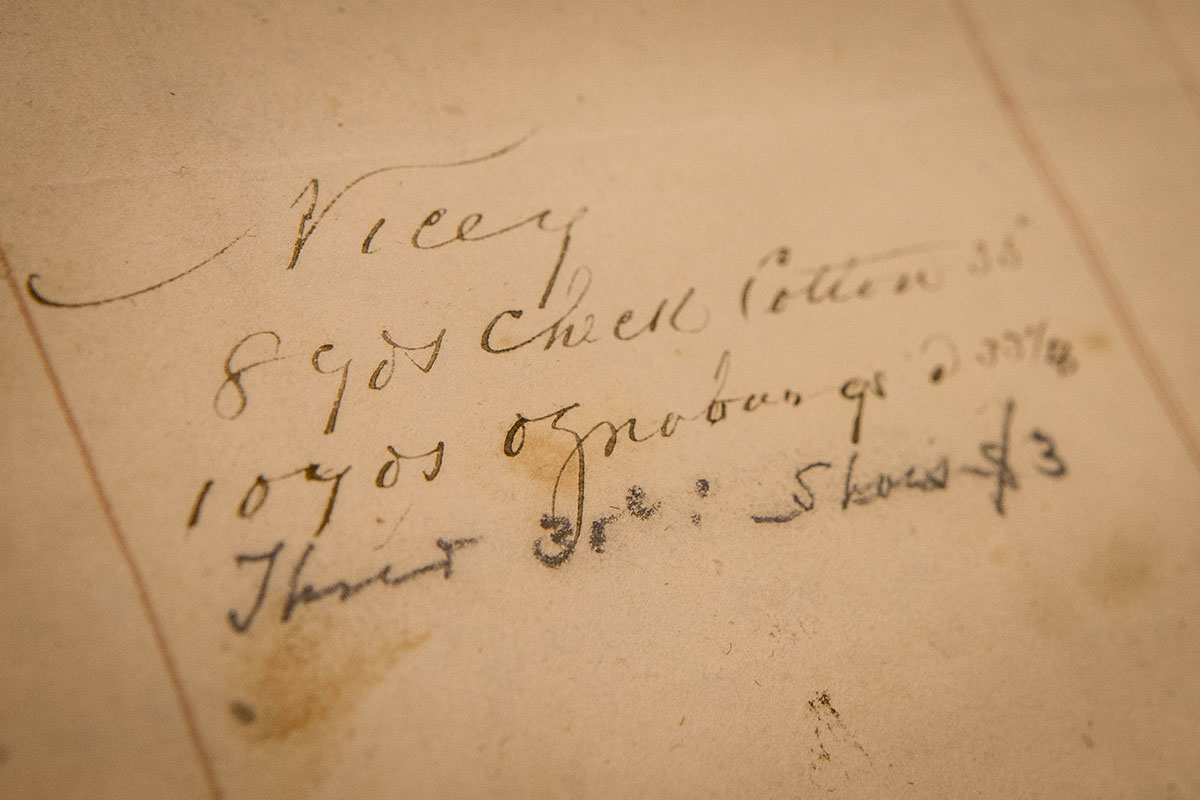 Nicey's name appears again, this time listed above an order for cloth to make her clothing. Her longtime partner, Isham, is listed on the next page above an order for a men's suit of clothes.