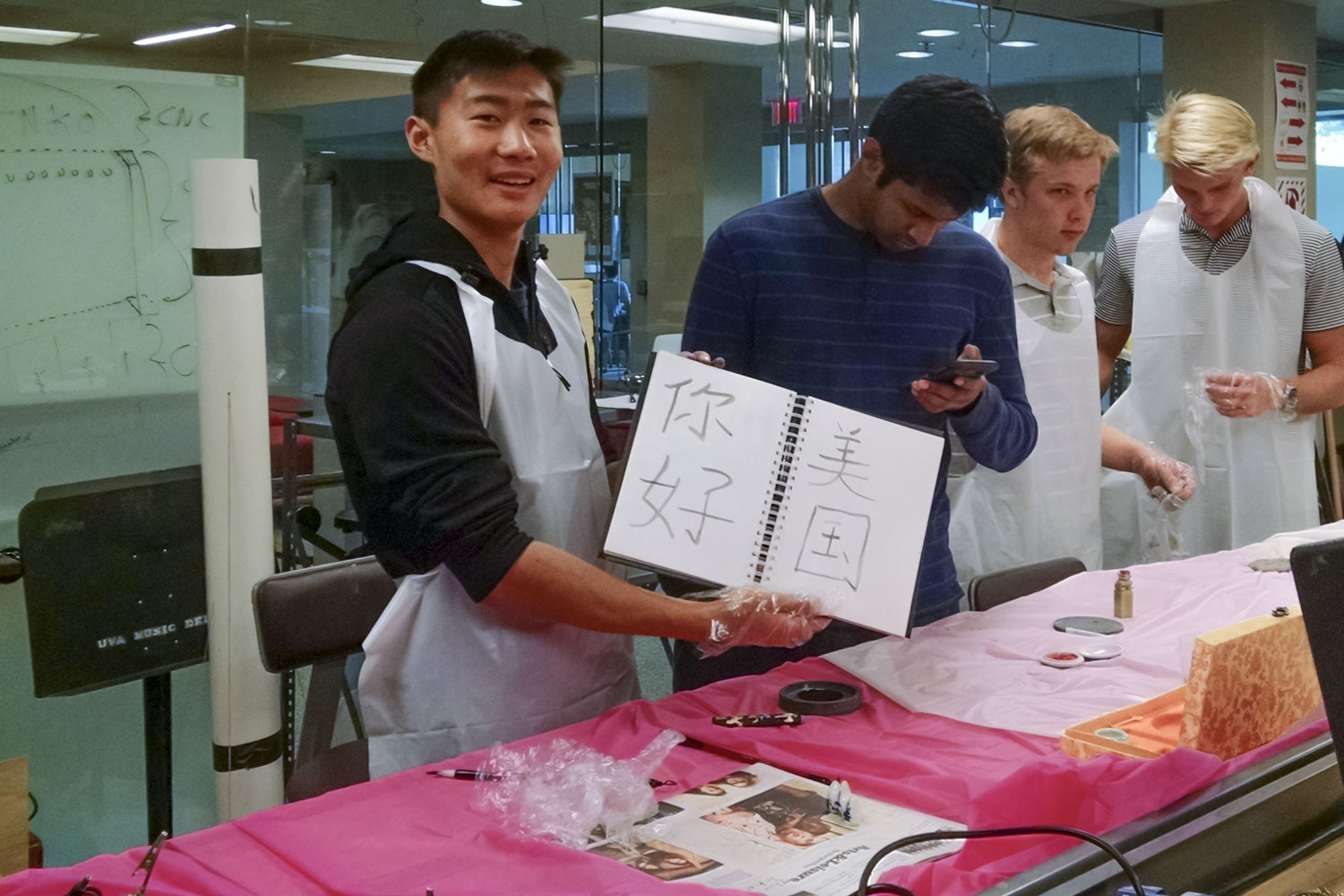 Richard Song demonstrates Chinese calligraphy, which he learned from his grandparents.