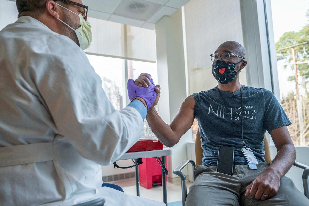 Dr. Taison Bell was among the first UVA Health employees to receive the COVID-19 vaccine at UVA and has been an outspoken advocate for the vaccine on social media. (Photo by Sanjay Suchak, University Communications)