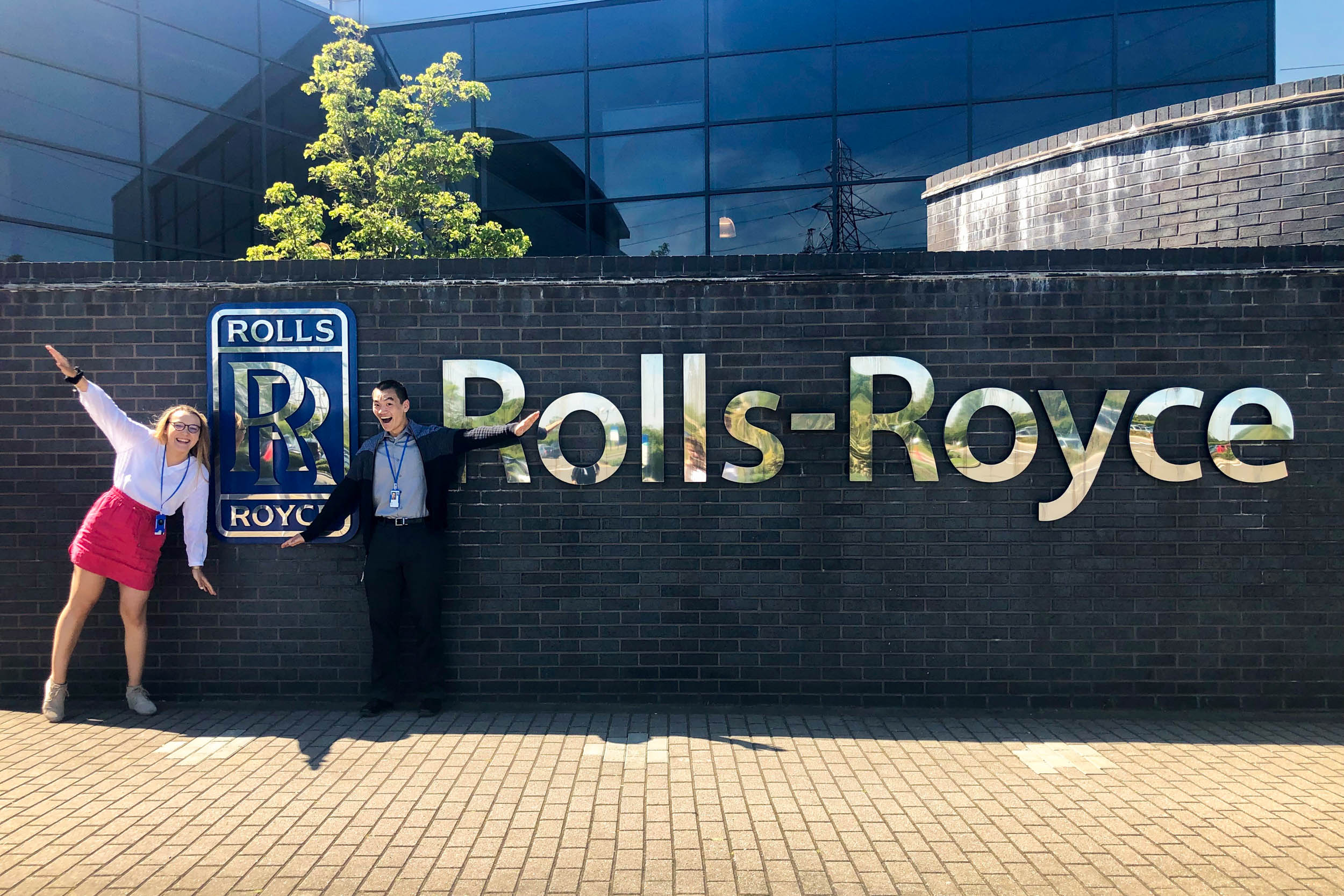 Mechanical engineering students Emily Davenport and David Xiao pose in front of the Rolls Royce building where they have been interning in Derby, United Kingdom.