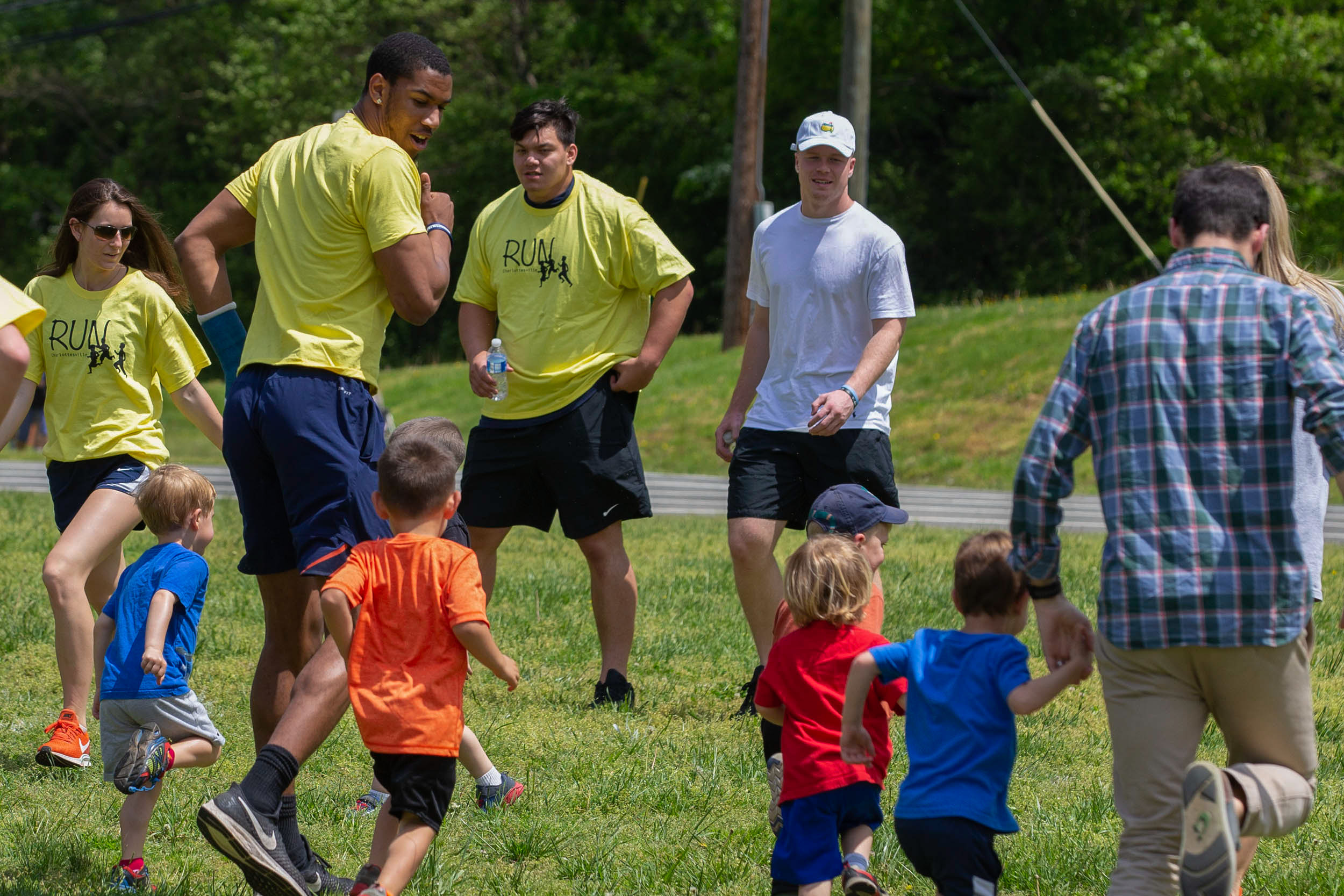 Volunteers included UVA football player Charles Snowden, shown here in an intense game of tag.