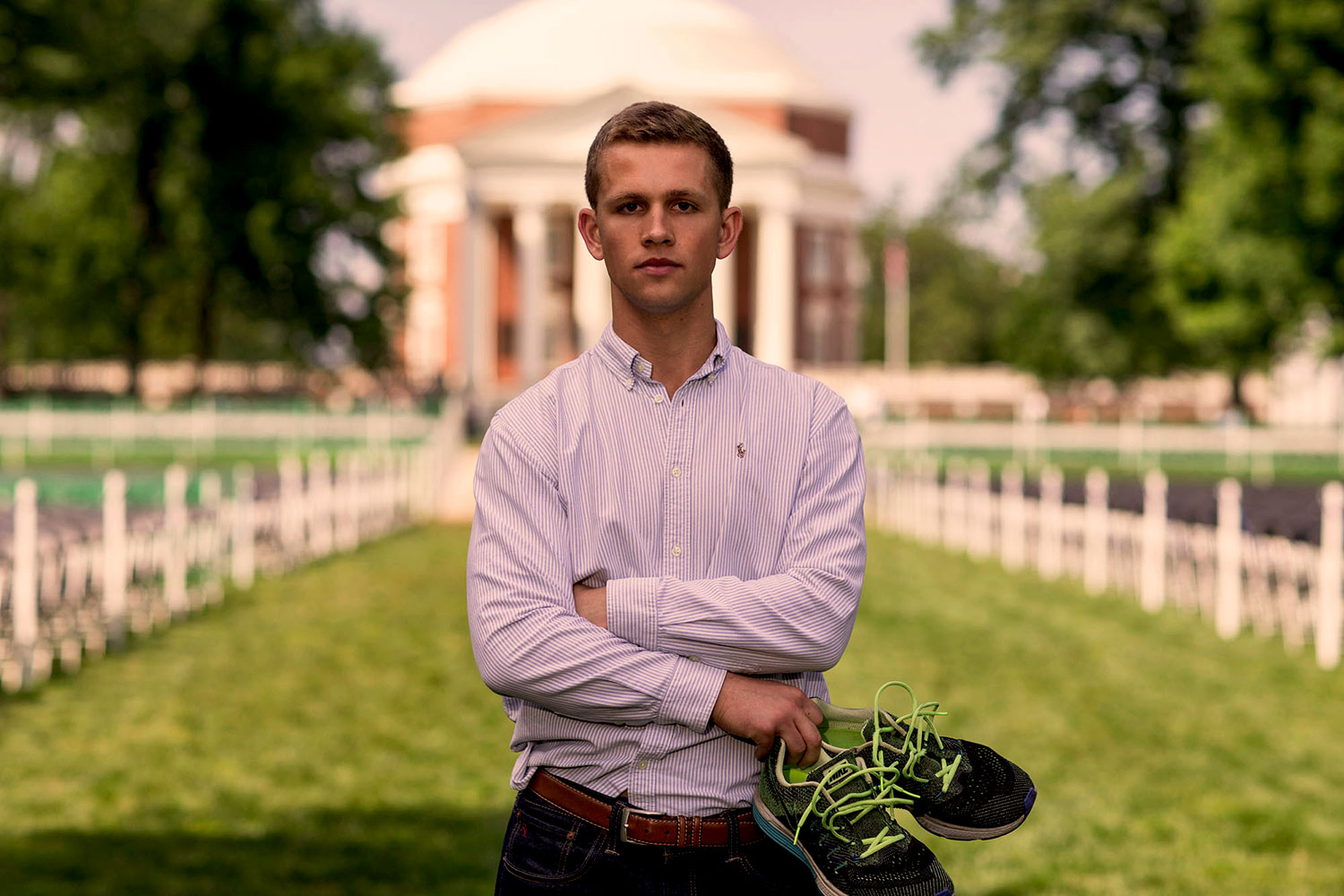 Recent UVA grad Sam Hitch runs on the Lawn in preparation for a cross-country triathlon that he will attempt this summer in order to raise money and awareness for pancreatic cancer research.
