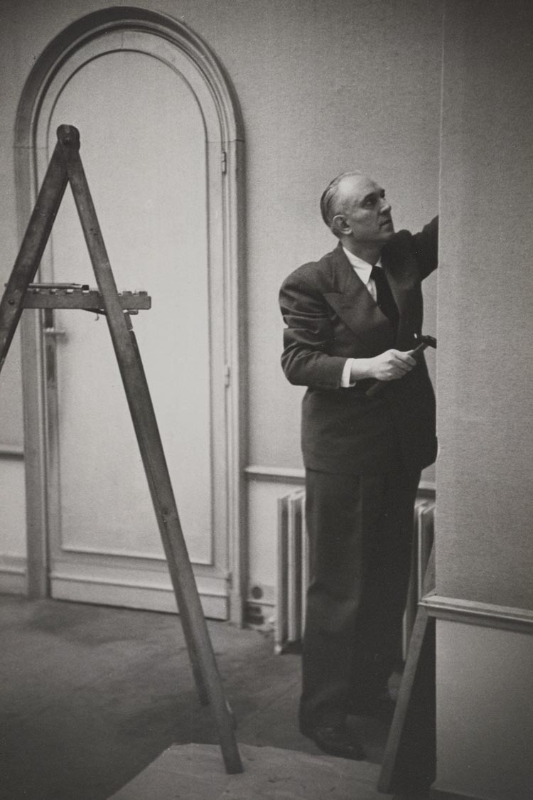 Samuel Kootz working on an exhibition in his gallery. Photo from the Kootz Gallery records, 1923-1966; the Archives of American Art at the Smithsonian Institution.