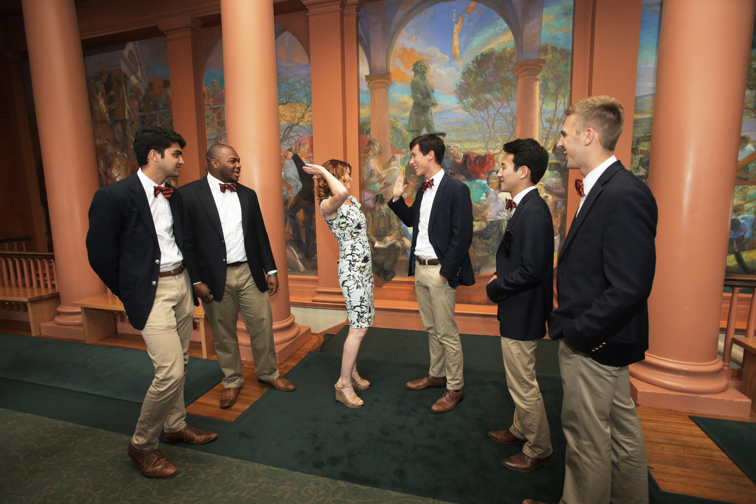arah Drew exchanges a high five with members of the Virginia Gentlemen. (Photos by Sanjay Suchak and Dan Addison)