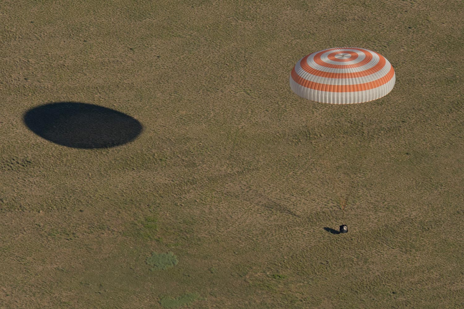 The Soyuz MS-07 spacecraft as it lands with crew members Anton Shkaplerov of Russia, Scott Tingle and Norishige Kanai of Japan, all returning from 168 days aboard the space station.