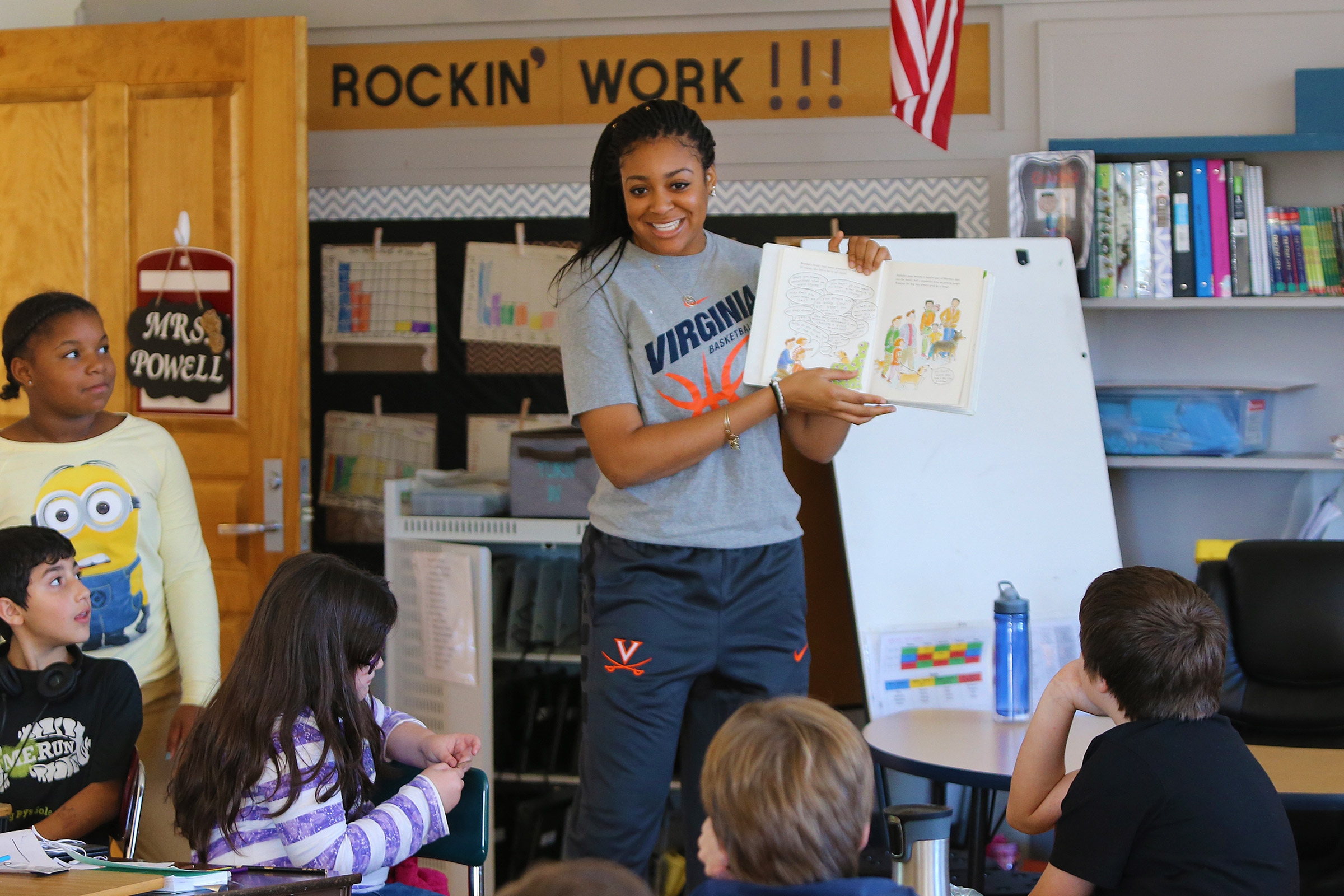 Third-year women's basketball player Shakyna Payne reads to a class at Clark Elementary School.