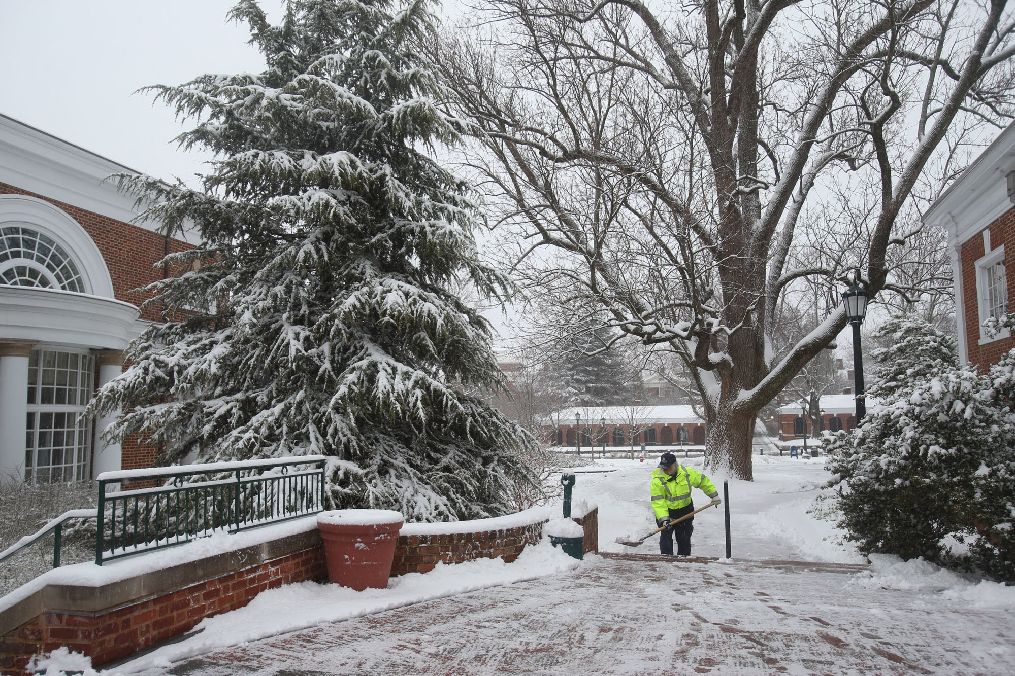 facilities worker removing snow
