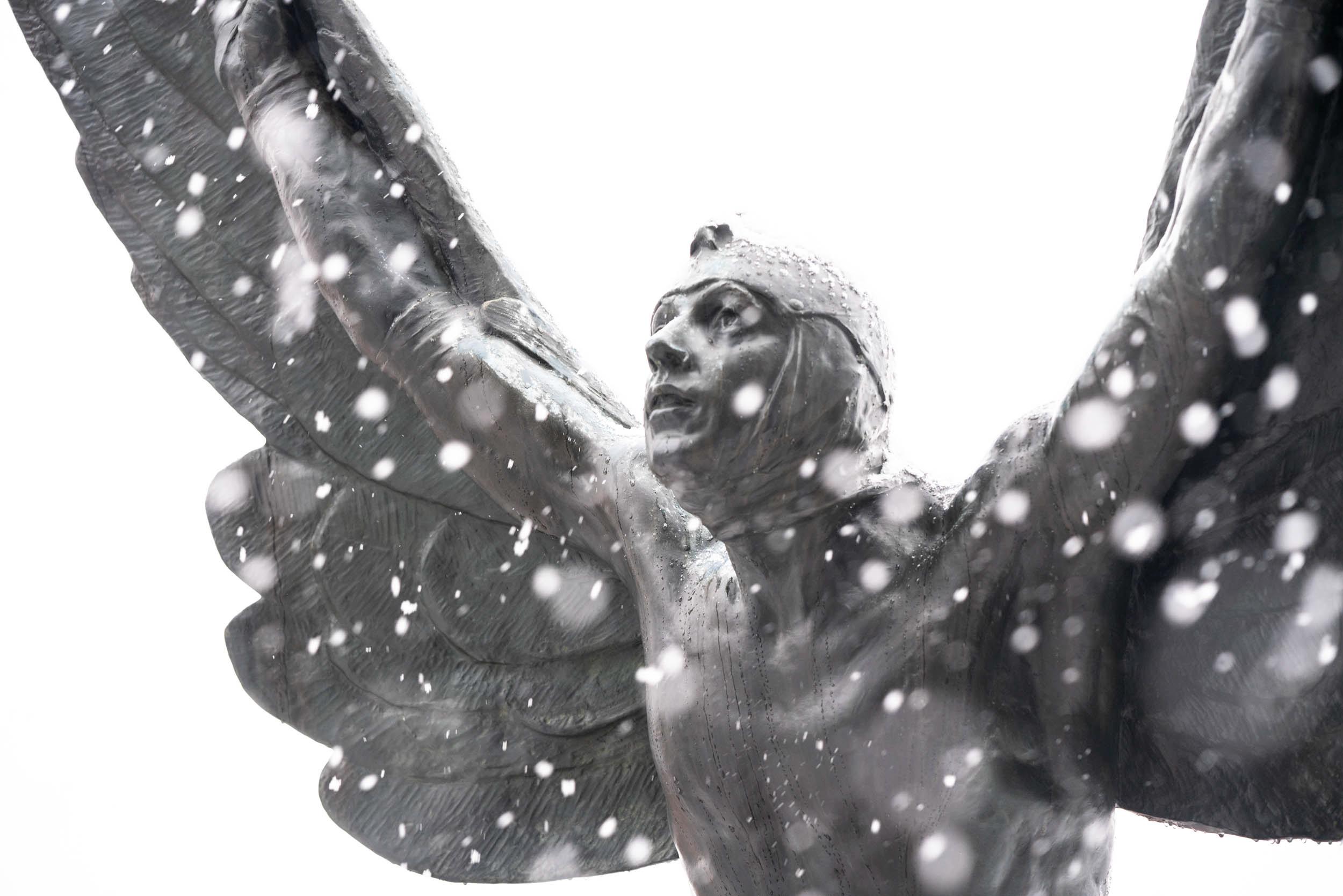 """""""The Aviator"""" against a snowy sky."""