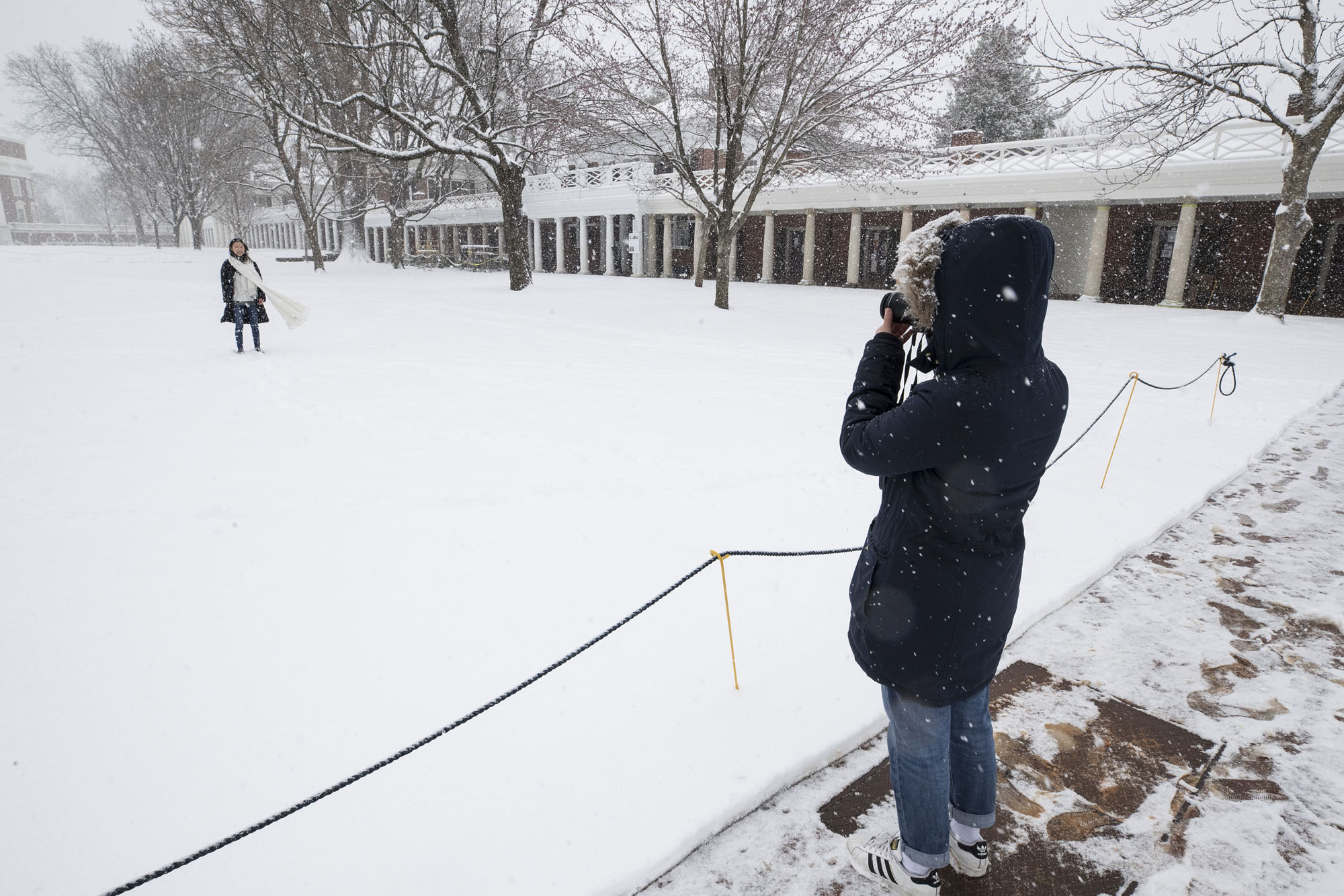 Student taking a picture on Grounds