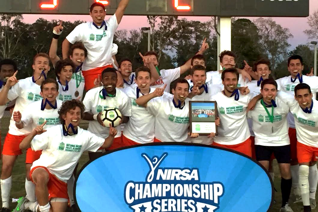 Members of the men's club soccer team celebrate their win at the NIRSA National Soccer Championships, held in Foley, Alabama.