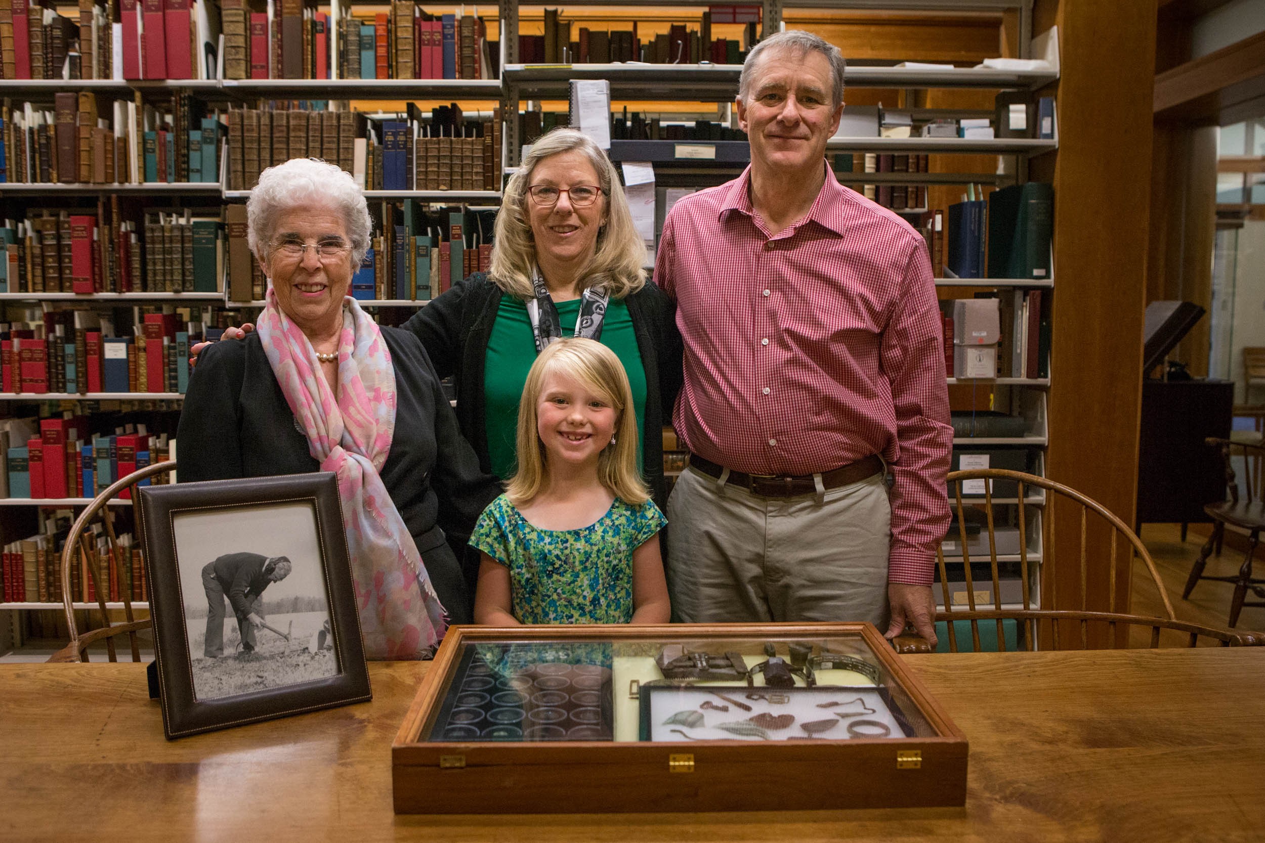 Raymond Shaw's family displays the donation of his Civil War artifacts. From left to right: Gretta Shaw, Lori Pollard, Morgan Shaw (center), and David Shaw. (Photo by Sanjay Suchak/University Communications)