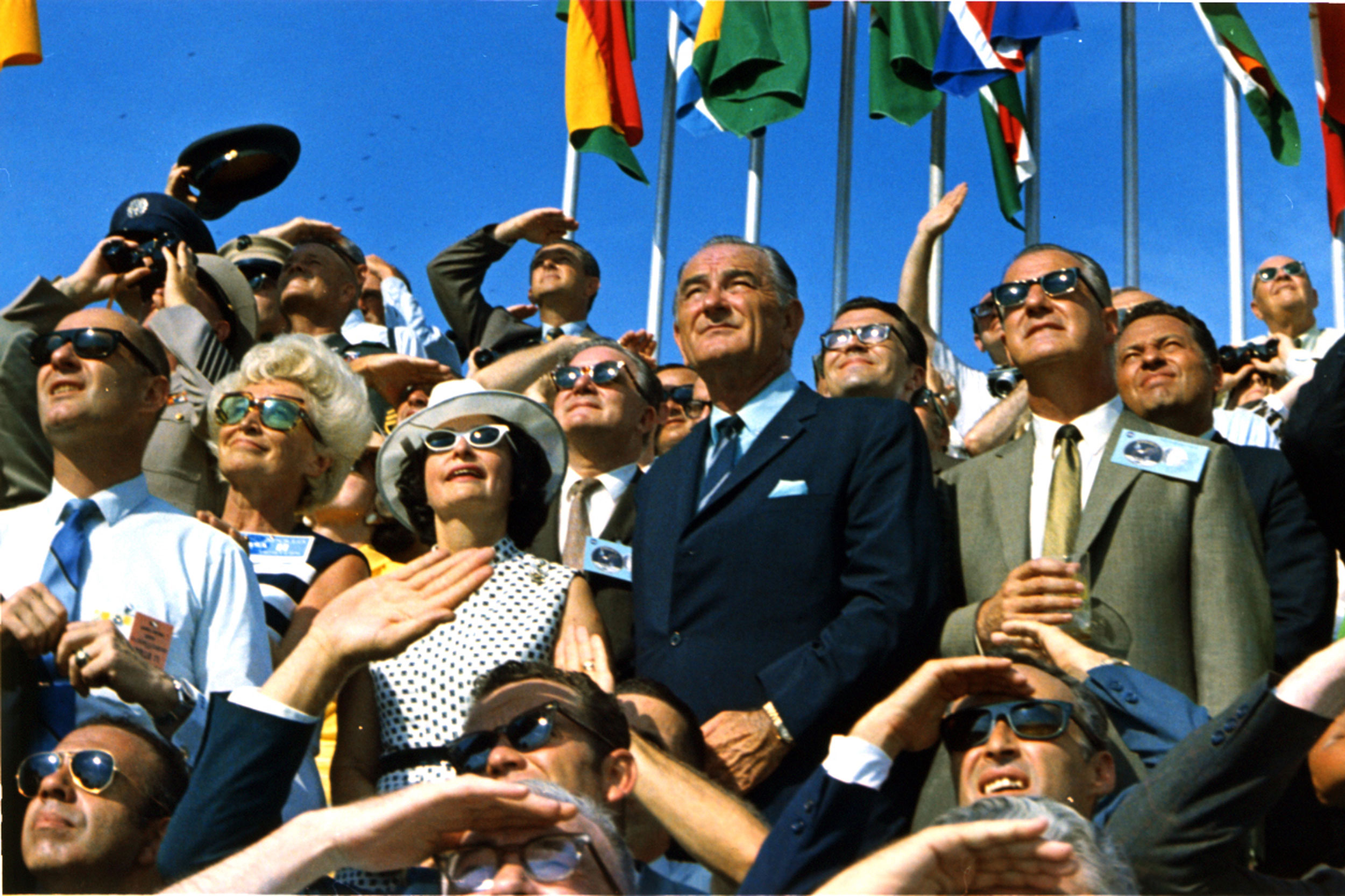 Former Vice President Lyndon Johnson, center, and former first lady Lady Bird Johnson, left, watch the launch of Apollo 11 with Vice President Spiro Agnew, right, in 1969.