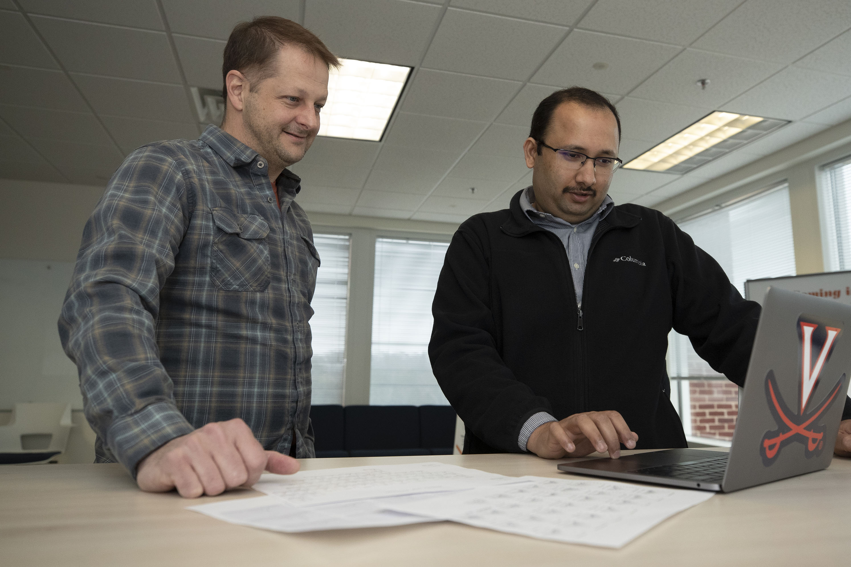 Srinivasan Venkatramanan, right, and Bryan Lewis are working with AccuWeather to understand weather and flu outbreak patterns.
