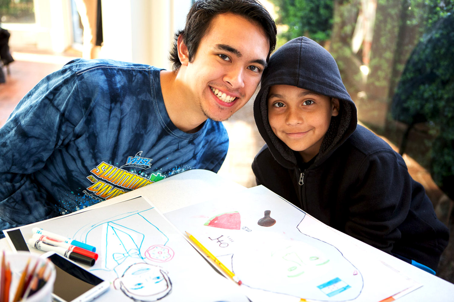 Second-year student Jacob McLaughlin and his mentee work on their self portraits. (Photos by Stacey Evans)