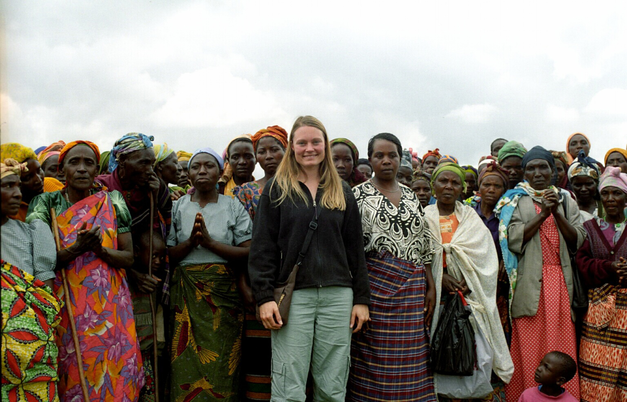 Standing here with women in a Uganda village, Gretchen Steidle founded the nonprofit Global Grassroots to help women in Africa.