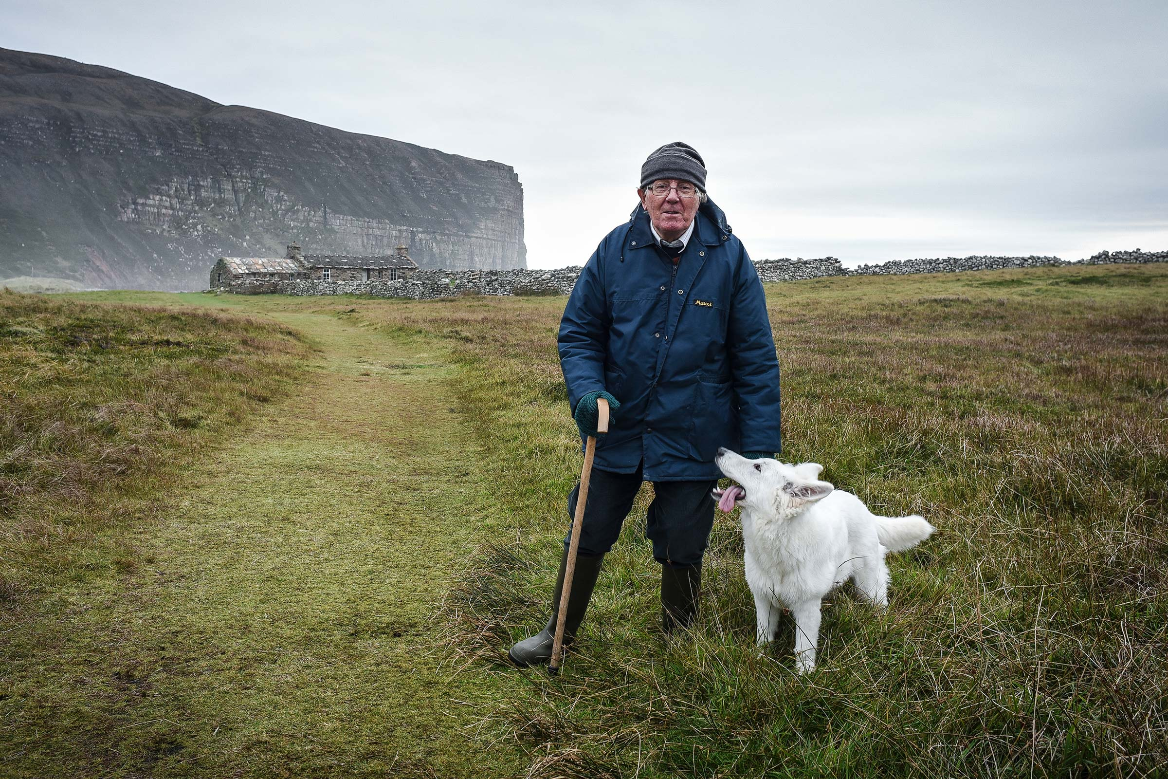Jeff Clark, one of five full-time residents living near a bothy on the Isle of Hoy, with his dog Skye.