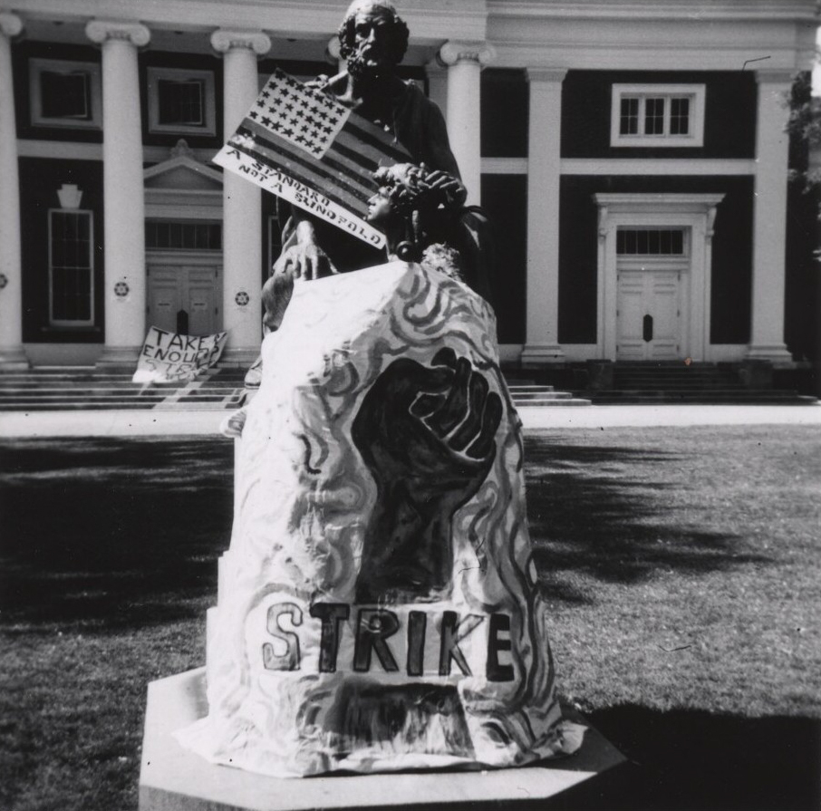 Students added strike signage to the Homer statue on the Lawn during the May Days protests.
