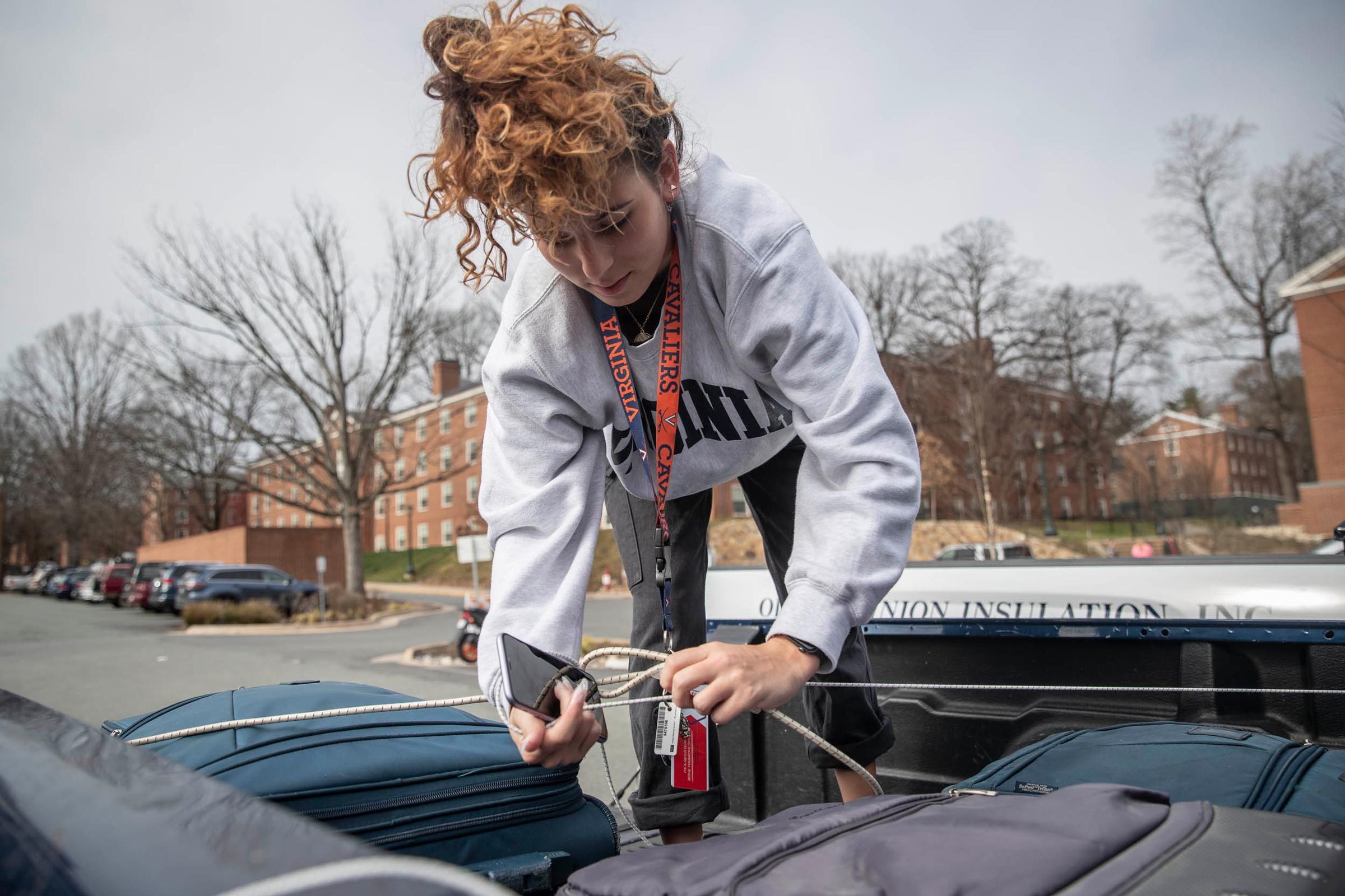 First-year student Tiana Santana from North Carolina secures her suitcases in the back of a truck as she moves out of her dorm. The University gave students until noon Wednesday to retrieve any belongings they wanted