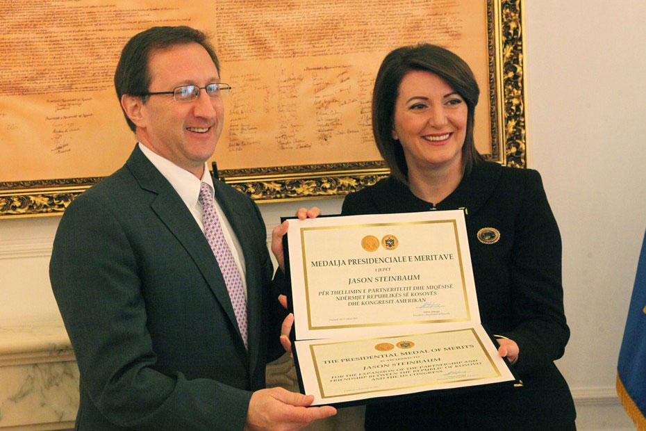 President Atifete Jahjaga, right, presented Jason Steinbaum with a Presidential Medal of Merit during a ceremony held Wednesday in Pristina, Kosovo.