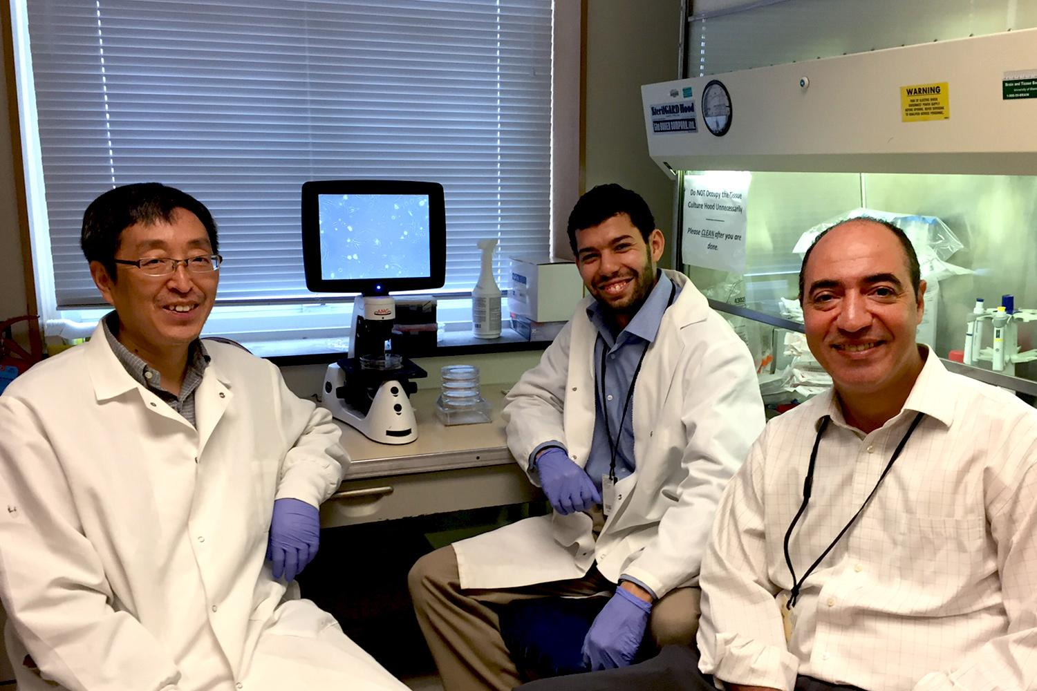 From left, Kangping Du, graduate student Mouadh Benamar and Tarek Abbas are part of the UVA team that has identified pevonedistat's cancer-stopping properties.