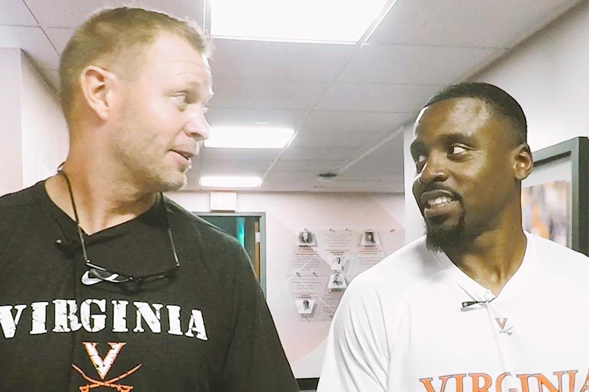 "UVA head football coach Bronco Mendenhall, left, calls Ahmad Hawkins, right, ""just a positive presence"" around the Cavalier football team."